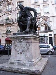 https://upload.wikimedia.org/wikipedia/commons/thumb/c/c6/Diderot-statue.jpg/220px-Diderot-statue.jpg
